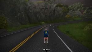 Bild: Zwift-cyklist på tempocykel längs vägen